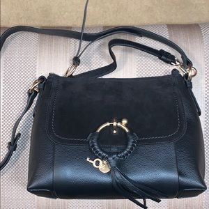See by Chloe new black purse never used